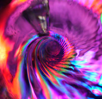 Looking down vortex of Quantum WoLF Water Structuring device shows actuall colors in how the wolf works