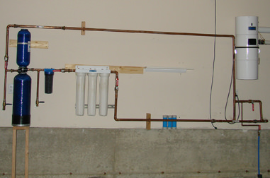 Plumbing and filtration ahead of WoLF Installation on garage wall.