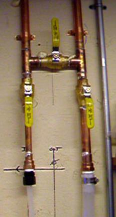 WoLF installation in garage showing plumbing redirect valve