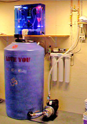 WoLF installation for whole home in garage; showing WoLF, Tank, smart pump, 3 stage filter, plumbing and wiring.